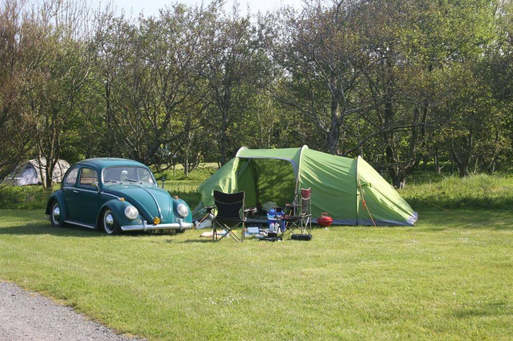 Relax in our landscaped campsite, with outstanding panoramic sea views